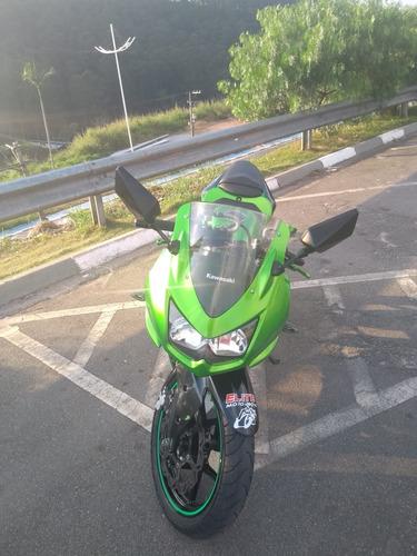 vendo ou troco por moto menor com volta .