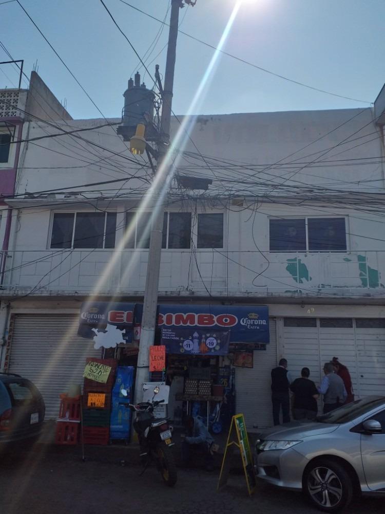 vendo propiedad 2 locales 3 deptos. frente mercado san loren