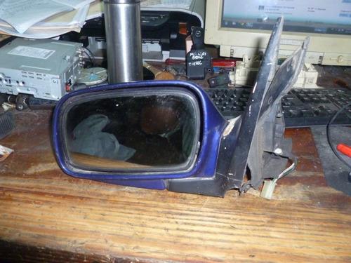 vendo retrovisor de puerta izquierda de kia delta, año 1999