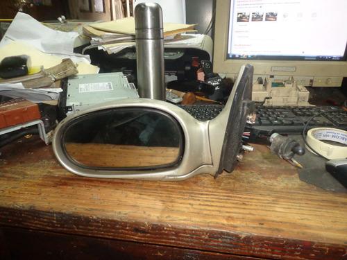 vendo retrovisor izquierda de  kia rio año 2003