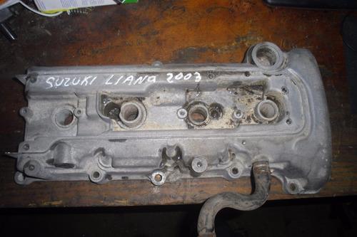 vendo tapa valvula de motor  de suzuki liana año 2003
