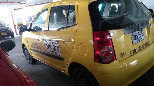 vendo taxi coopebombas medellin