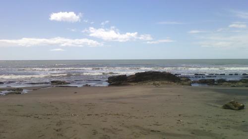 vendo terreno a las vista y orilla a la playa de casares