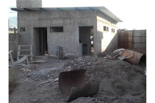 vendo terreno con local comercial en construcción