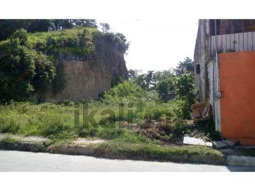 vendo terreno de 1500 m² en colonia centro de tuxpan veracruz, terreno en forma rectangular, junto a un cerro rebajado al nivel de la calle, con una leve inclinación hacia la calle, se encuentra ubic
