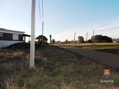 vendo terreno en punta colorada sobre avenida principal