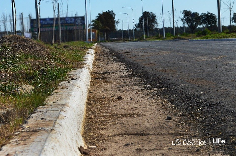 vendo terrenos en lapachos 1 - calle pavimentada