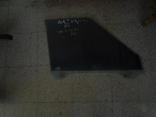 vendo vidrio delantero izquierdo de mazda 323año 1984