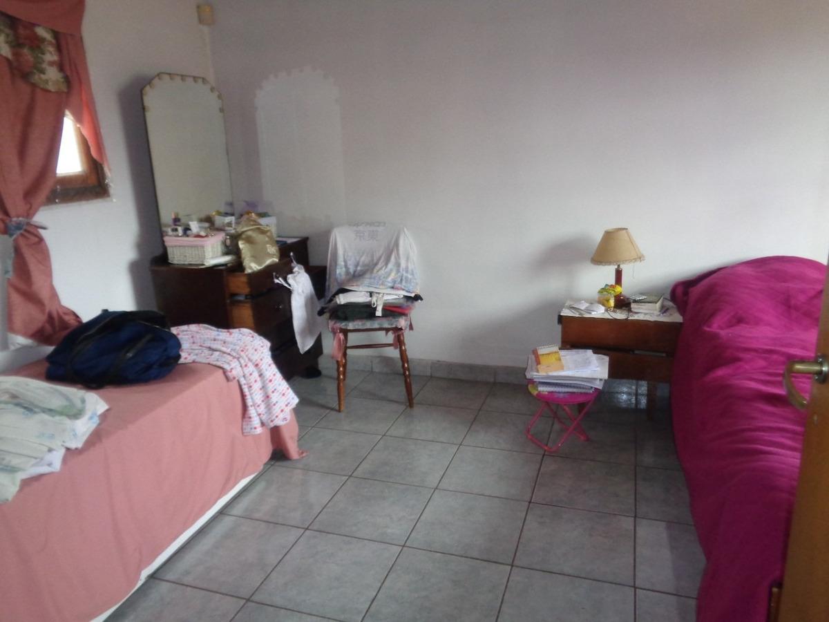 venta de casa en burzaco , a mts de av hipolito yrigoyen