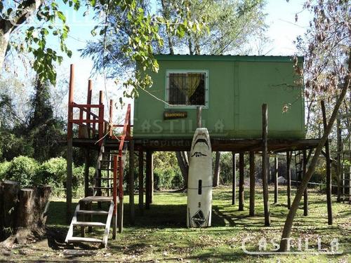 venta de casa sobre el arroyo caraguatá