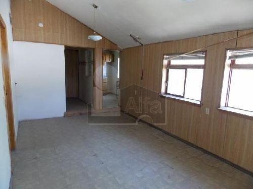 venta de terreno con 3 casas en el interior