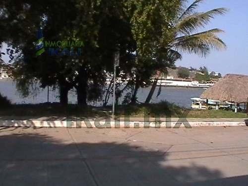 venta de terreno en tuxpan, veracruz. ubicado en santiago de la peña frente al rio, con una vista espectacular del puerto, con una superficie de 770 m² y 350 m² de zona federal, cuenta con todos los