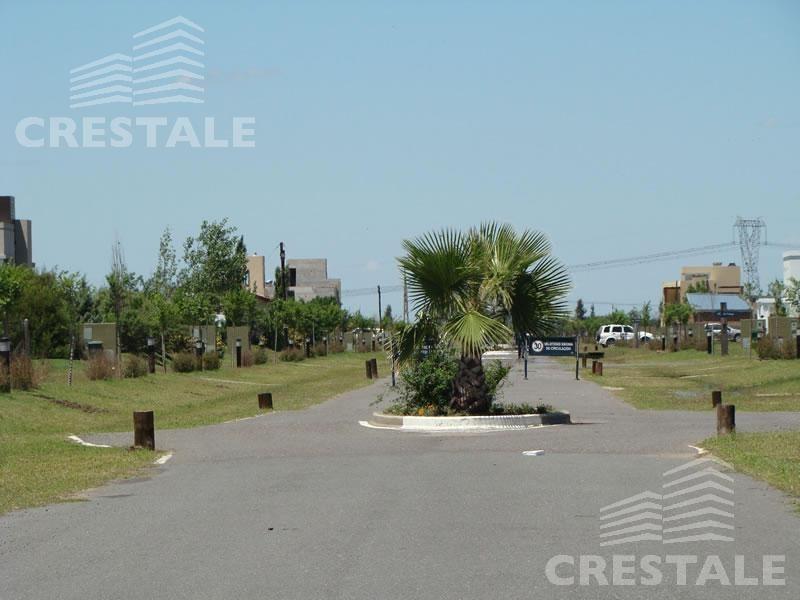 venta terreno sobre el lago - puerto roldán barrio cerrado.
