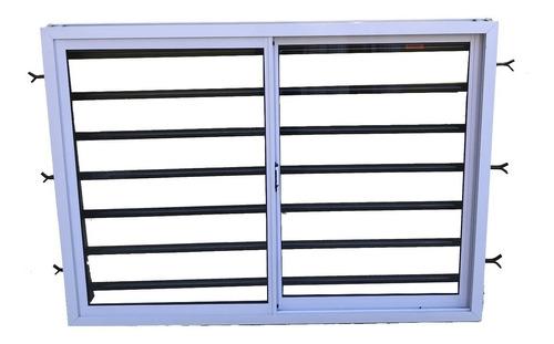 ventana aluminio blanco brillante con vidrio 150x110 con reja tubo refrozada de 1.2mm  dentro de mocheta