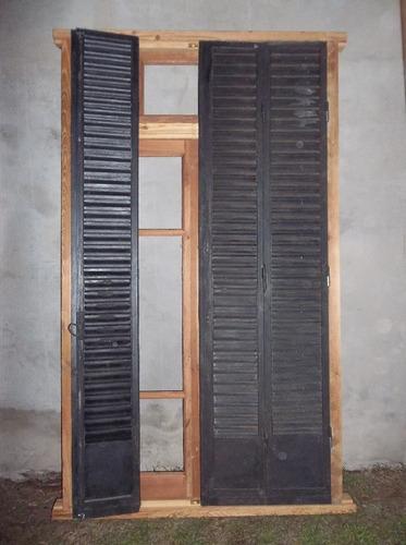 ventana con celosías de hierro.
