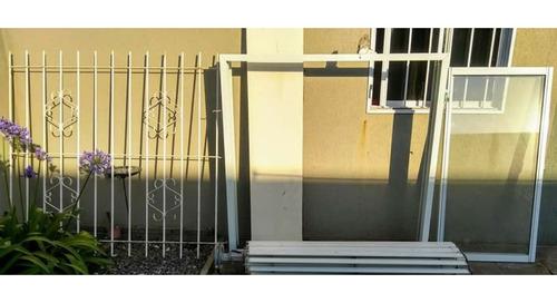 ventana de aluminio corrediza con persiana y reja