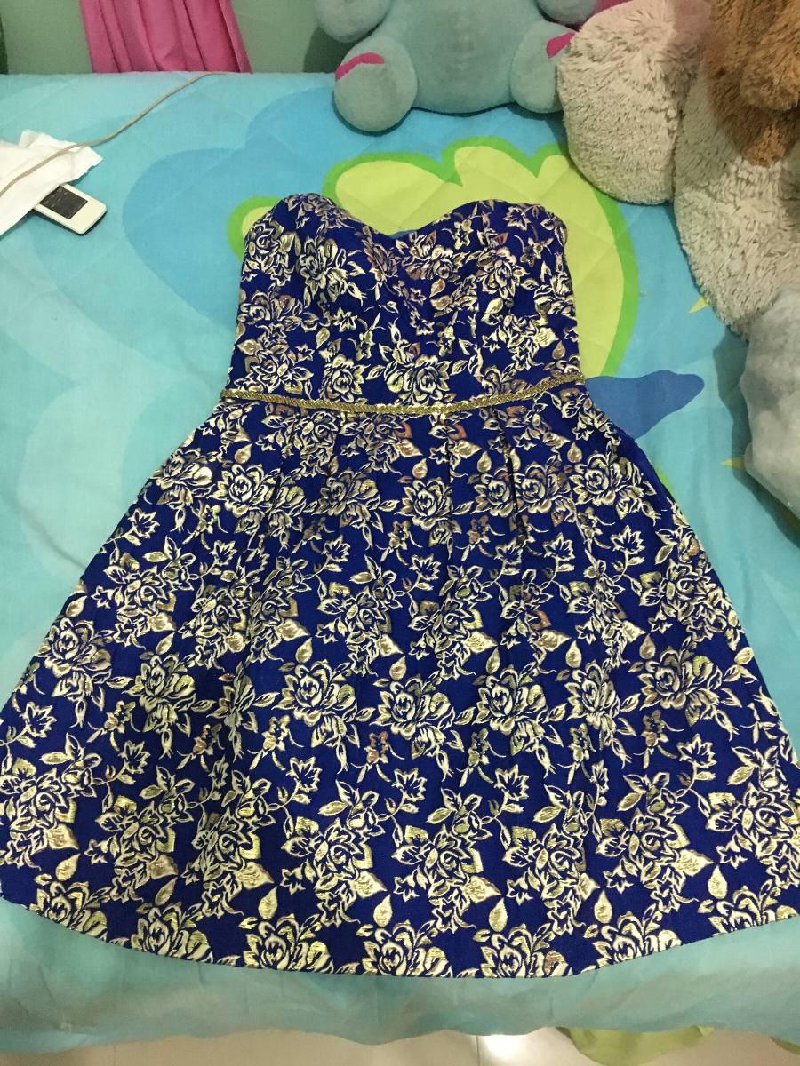 Foto de vestido azul o dorado