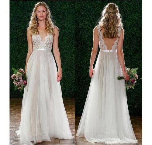 vestido bellísimo de novia lúdica y romántica, encaje y gasa