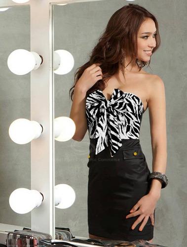 vestido curto na cor preto e braco . lindissimo