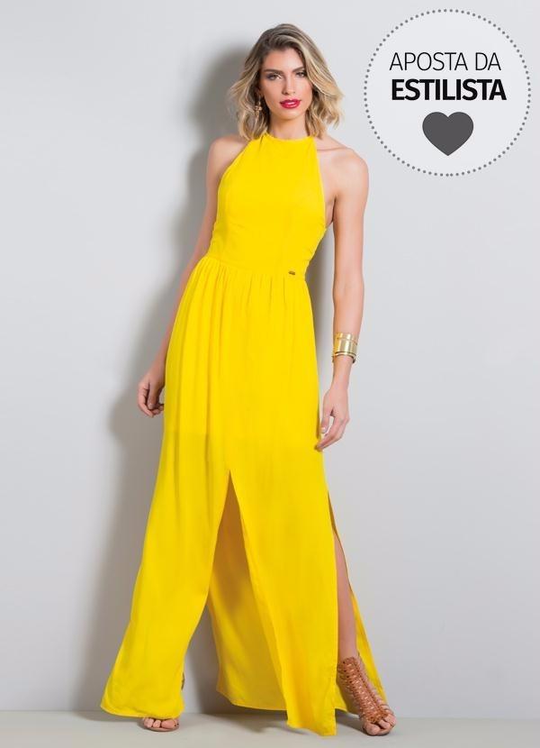 fa5c34643c vestido longo amarelo frente única com fenda quintess. Carregando zoom.