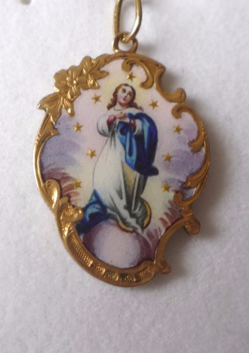 virgen portuguesa.en oro 18 kt. cincelada.origen portugués .