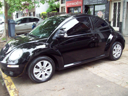 volkswagen new beetle 2.0 advance... dincar
