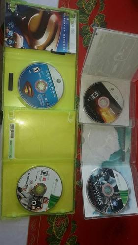 xbox 360 e original. sin chispear y sus juegos originales.