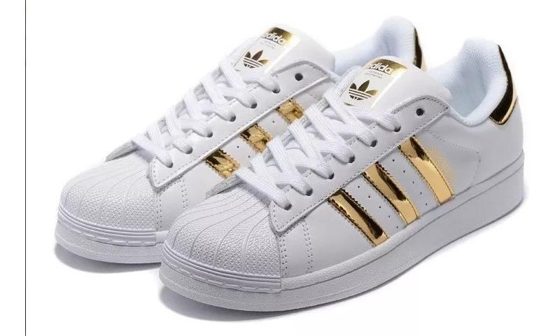 zapatillas adidas superstar blancas con dorado