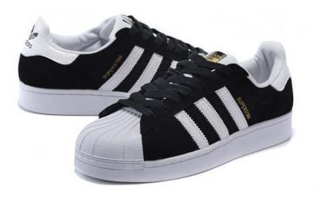 zapatilla adidas negras y blancas