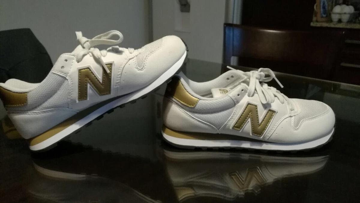 new balance blancas con dorado