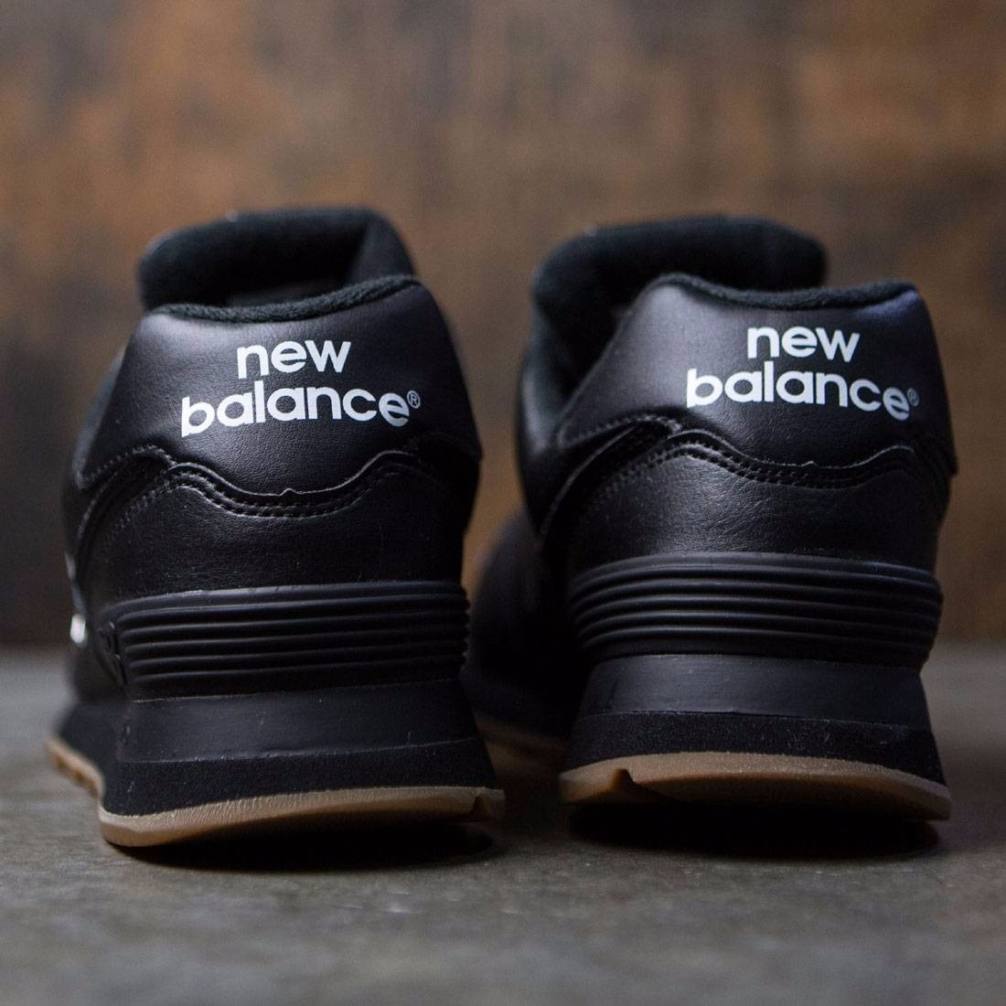 new balance negras piel hombre