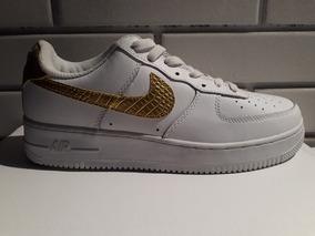 zapatillas nike blancas doradas