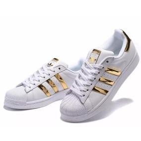 tenis adidas superstar blanco con dorado