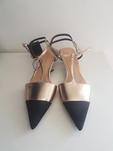 zara nuevos zapatos metalizados puntera negra. importados