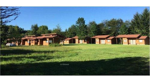 zonasur.cl propiedades; venta complejo turístico 7 cabañas , 1 casa , otras construcciones, a 1.5 km de la ciudad