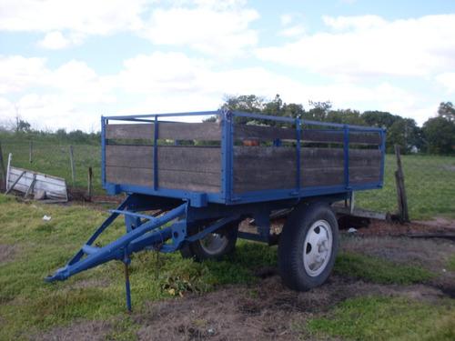 zorras agricolas y barriles para agua